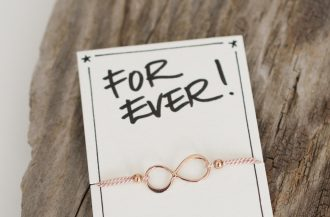 Wunscharmband Infinity in rosé-vergoldetem 925 Silber auf Naturseide